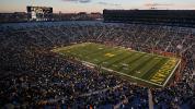 Ex-Michigan player threatens Harbaugh online