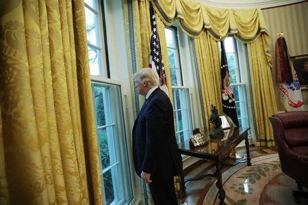 U.S. President Donald Trump looks out a window of the Oval Office following an interview with Reuters at the White House in Washington, U.S., April 27, 2017. REUTERS/Carlos Barria