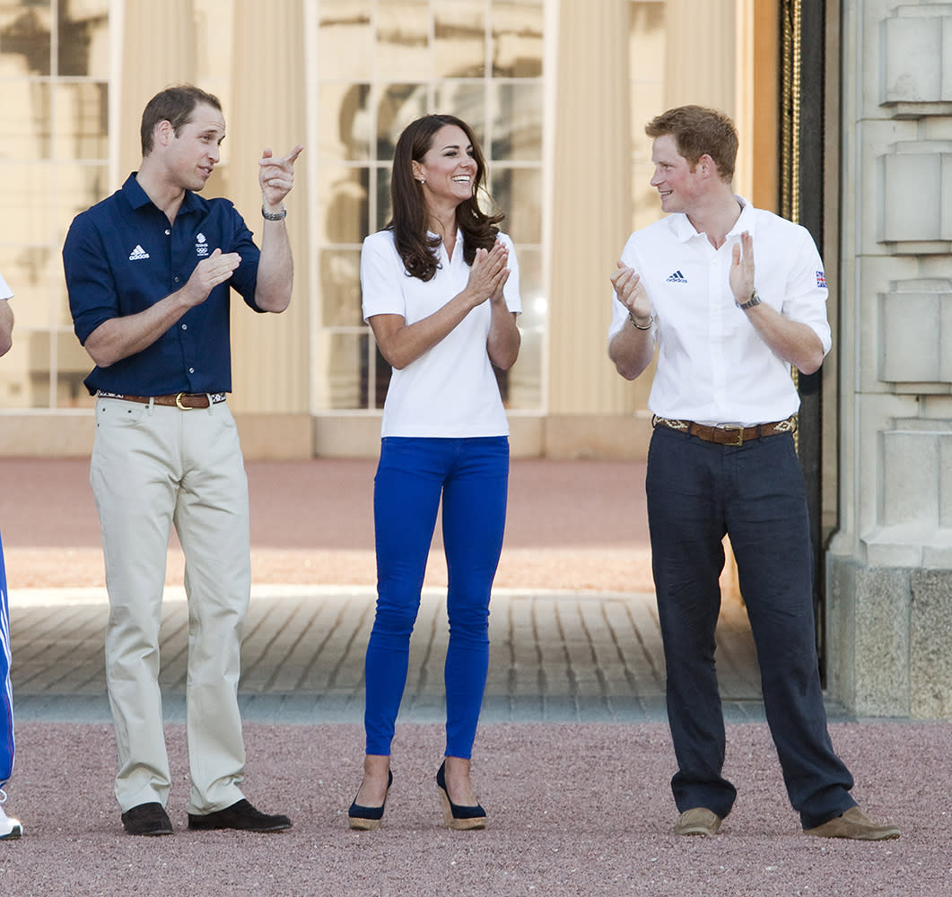 Our three favorite royals wait to receive the Olympic Torch at Buckingham Palace on it's route around Britain to the Olympic Stadium.