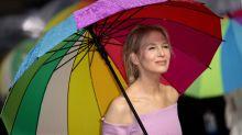 Renée Zellweger pays homage to Judy Garland with glorious rainbow umbrella