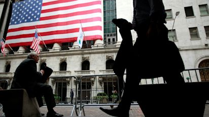 Wall Street retreats from record highs