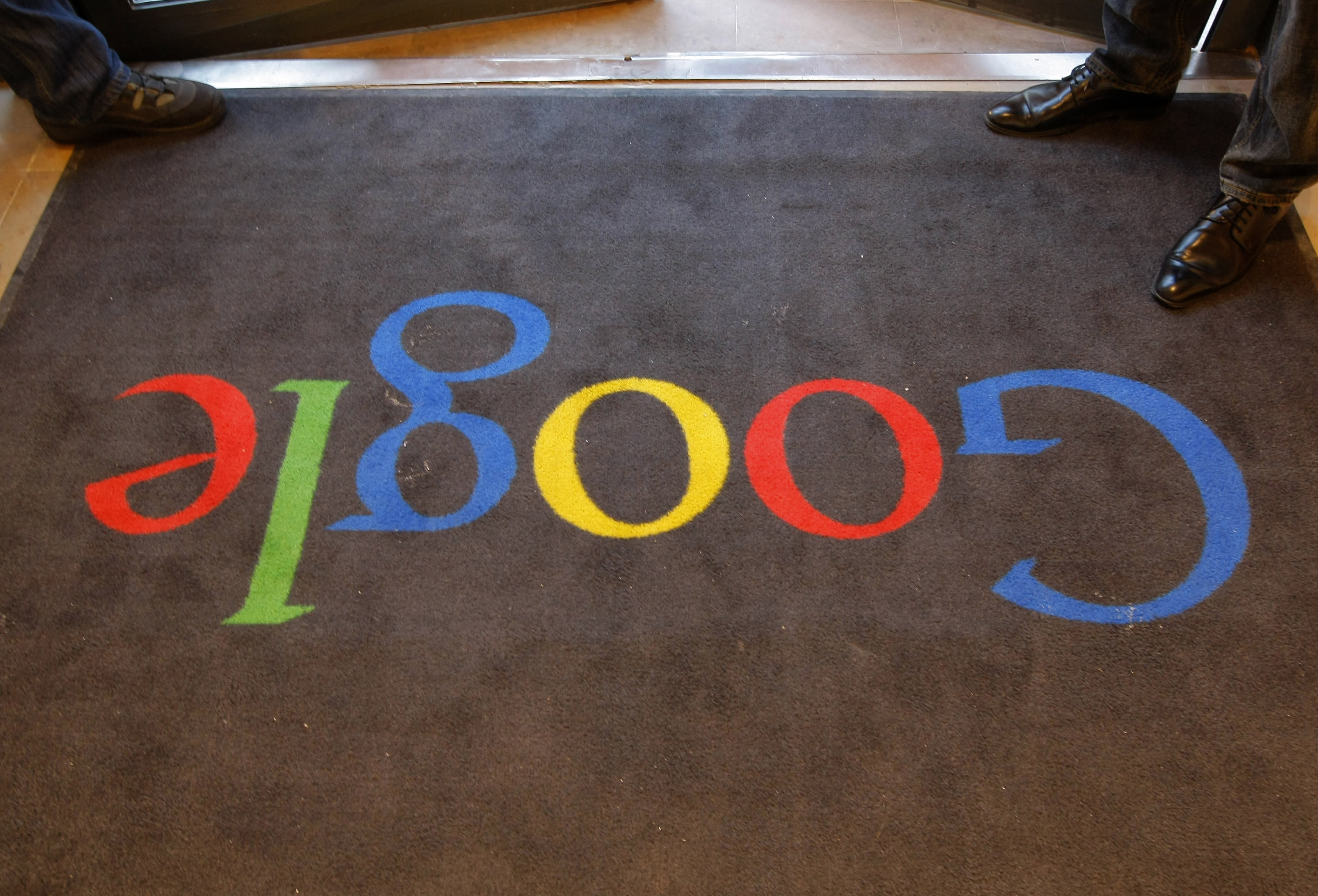 FILE - In this Tuesday, Dec. 6, 2011 file photo, a carpet at the entrance of Google France's new offices before its inauguration by French President Nicolas Sarkozy, in Paris. Google's new privacy policy is under attack from regulators in its largest European markets, who on Tuesday, April 2, 2013 brought legal action to try and force the company to overhaul practices they say let it create a data goldmine at the expense of unwitting users. (AP Photo/Jacques Brinon, Pool-File)