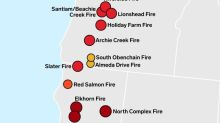 A color-coded map shows the biggest wildfires raging up and down the West Coast
