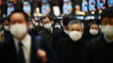 Japan PM defends school closure plan despite critics