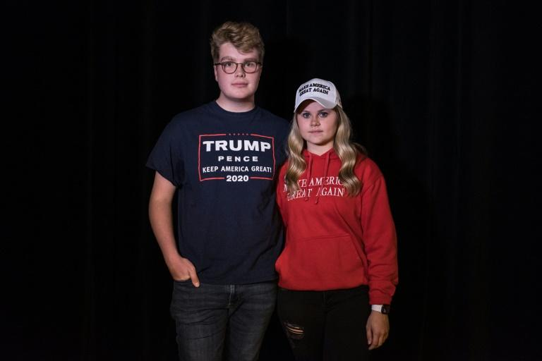 Clay Danec and Olivia Myers, both 18 years old, are ready to vote for Donald Trump in next year's presidential election (AFP Photo/)