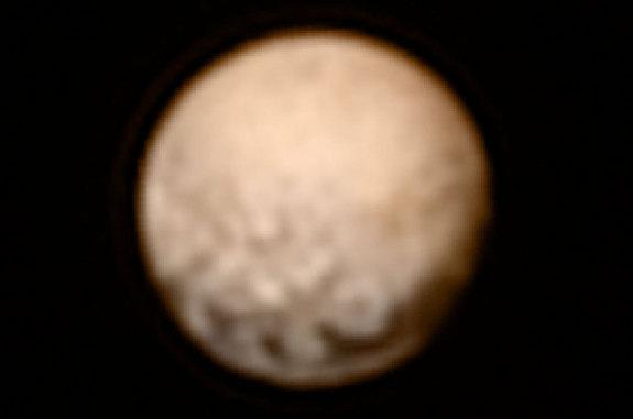 Colorized photo of Pluto as taken by the New Horizons spacecraft on July 3, 2015 at a distance of 8.3 million miles from the dwarf planet.