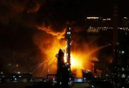 Fire and smoke are seen at state oil major PetroChina's plant in Dalian, Liaoning province, China August 17, 2017. REUTERS/Stringer