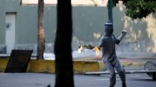 Hooded youths in Venezuela mar opposition efforts at peaceful protest