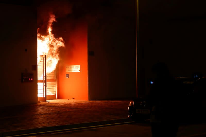 Anti-government protesters set alight the lobby of a newly built residential building that authorities planned to use as a quarantine facility, as public fears about the coronavirus outbreak intensify in Hong Kong