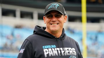 Ex-Panthers coach sells old gear for charity