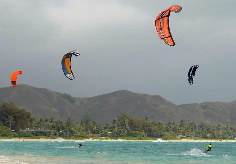 Kite surfers enjoy increasing winds ahead of Hurricane Douglas in the windward town of Kailua on the island of Oahu, Hawaii on July 26, 2020. (AFP Photo/Ronen ZILBERMAN)