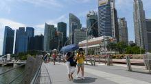 Singapore lowers growth forecast as virus hits economy