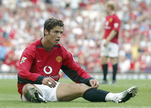 Manchester Uniteds new signing Cristiano Ronaldo after winning his team a penalty against Bolton Wanderers, during the FA Barclaycard Premiership match at Old Trafford, Manchester.