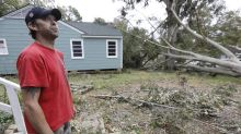 Storm system in Deep South leaves damage and death in its wake