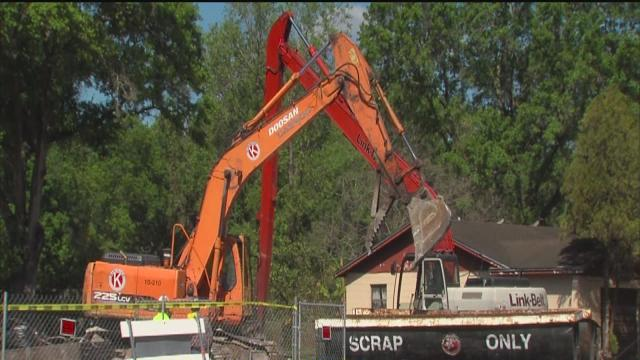 Sinkhole filled in, homes condemned