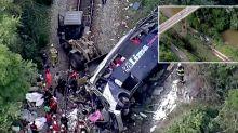 At least 16 dead after tour bus plummets off bridge