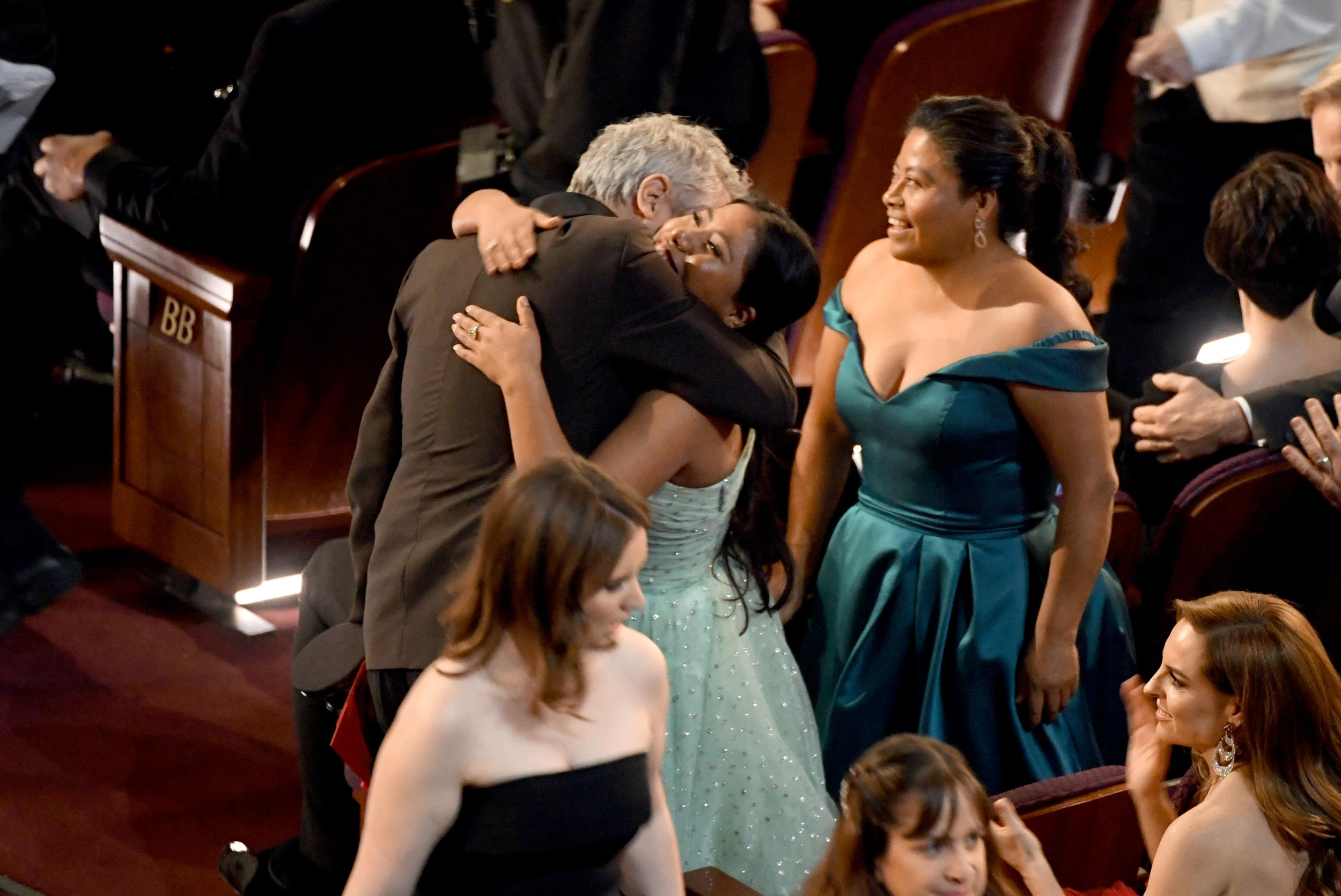 HOLLYWOOD, CALIFORNIA - FEBRUARY 24: (L-R) Alfonso Cuaron and Yalitza Aparicio react after Mr. Cuaron was announced as winner of the Cinematography award for 'Roma' onstage during the 91st Annual Academy Awards at Dolby Theatre on February 24, 2019 in Hollywood, California. (Photo by Kevin Winter/Getty Images)