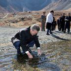 Fulfilling a dream, South Korea's Moon visits sacred North Korean mountain with Kim