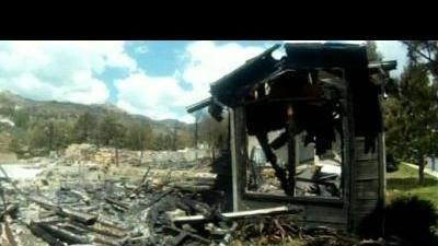 Locals assess wildfire damage