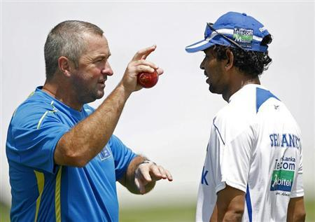 Sri Lanka's assistant coach Bayliss gestures as he speaks to Dilshan during practice session ahead of first test cricket match against Pakistan