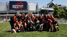 Denver Broncos cheerleaders participate in camp for children with special needs