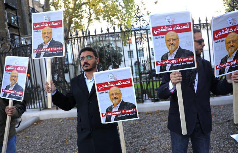 FILE PHOTO: People protest against the killing of journalist Jamal Khashoggi in Turkey outside the Saudi Arabian Embassy in London
