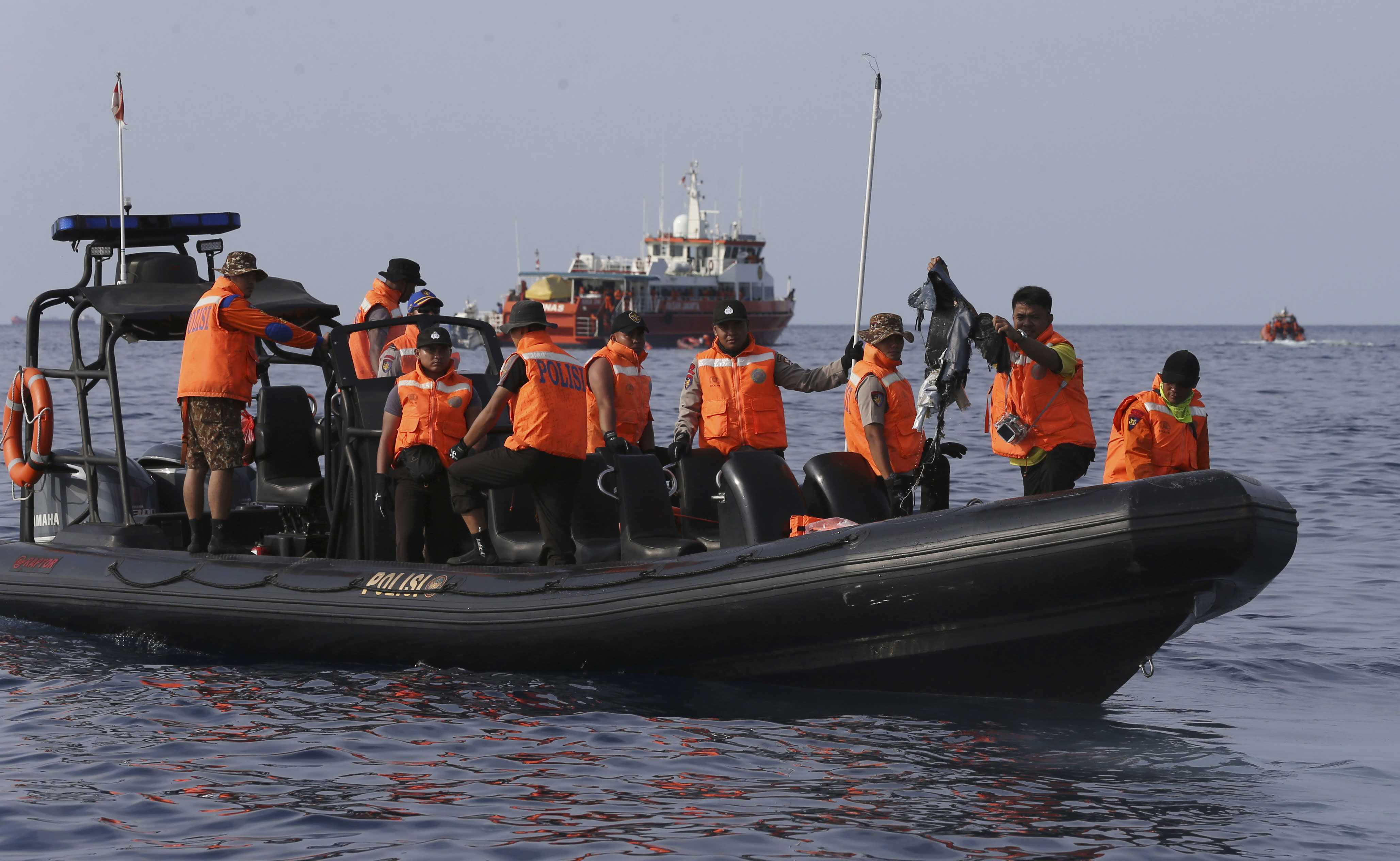 Rescuers conduct search operation in the waters of Ujung Karawang, West Java, Indonesia after a Lion Air plane crashed into the sea Monday, Oct. 29, 2018. A Lion Air flight crashed into the sea just minutes after taking off from Indonesia's capital on Monday in a blow to the country's aviation safety record after the lifting of bans on its airlines by the European Union and U.S. (AP Photo/Achmad Ibrahim)