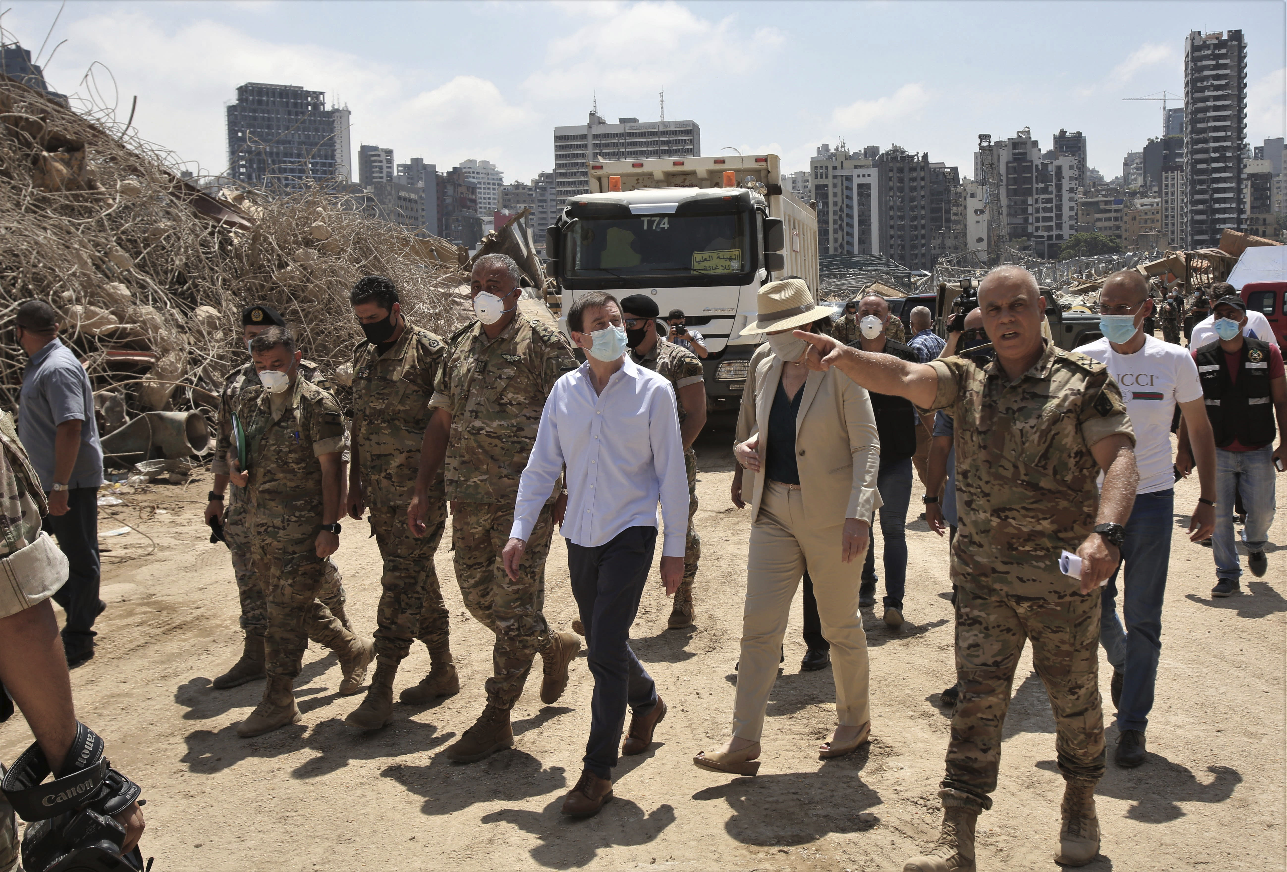 U.S. Undersecretary of State for Political Affairs David Hale, third from right, and U.S. Ambassador to Lebanon Dorothy Shea, second from right, visit the site of the Aug. 4 explosion in Beirut, Lebanon, Saturday, Aug. 15, 2020. (Nabil Monzer/Pool Photo via AP)