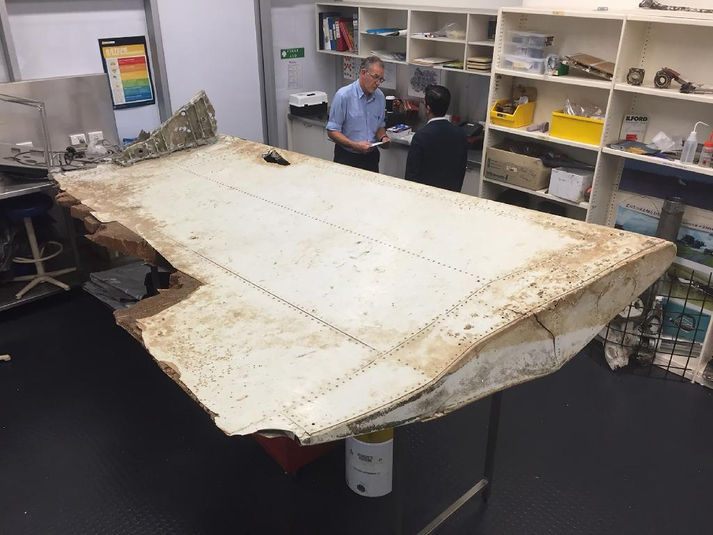 A large piece of debris found in Tanzania that has been confirmed as a part of a wing flap from missing Malaysia Airlines passenger jet MH370 (AFP Photo/)