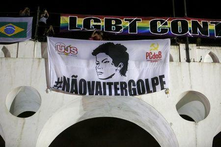 A banner with the image of Brazilian President Dilma Rousseff is displayed during a protest against her impeachment in Rio de Janeiro, Brazil, April 11, 2016. REUTERS/Pilar Olivares