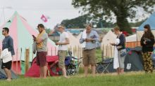 Former Shadow Chancellor Ed Balls and MP Yvette Cooper spotted queuing for the shower at Glastonbury