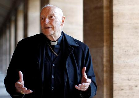 FILE PHOTO: Cardinal Theodore Edgar McCarrick smiles during an interview with Reuters at the North American College at the Vatican February 14, 2013. REUTERS/Alessandro Bianchi/File Photo