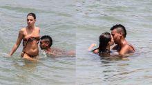 Solteira, Bruna Linzmeyer beija muito em dia de praia no Rio