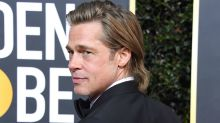 Brad Pitt couldn't wait to run into ex-wife Jennifer Aniston at the Golden Globes