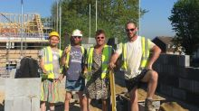 Bricklayers rock dresses and skirts to beat the heat and their 'no shorts' dress code