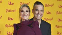 Ayda Field shares video of husband Robbie Williams cradling their newborn son