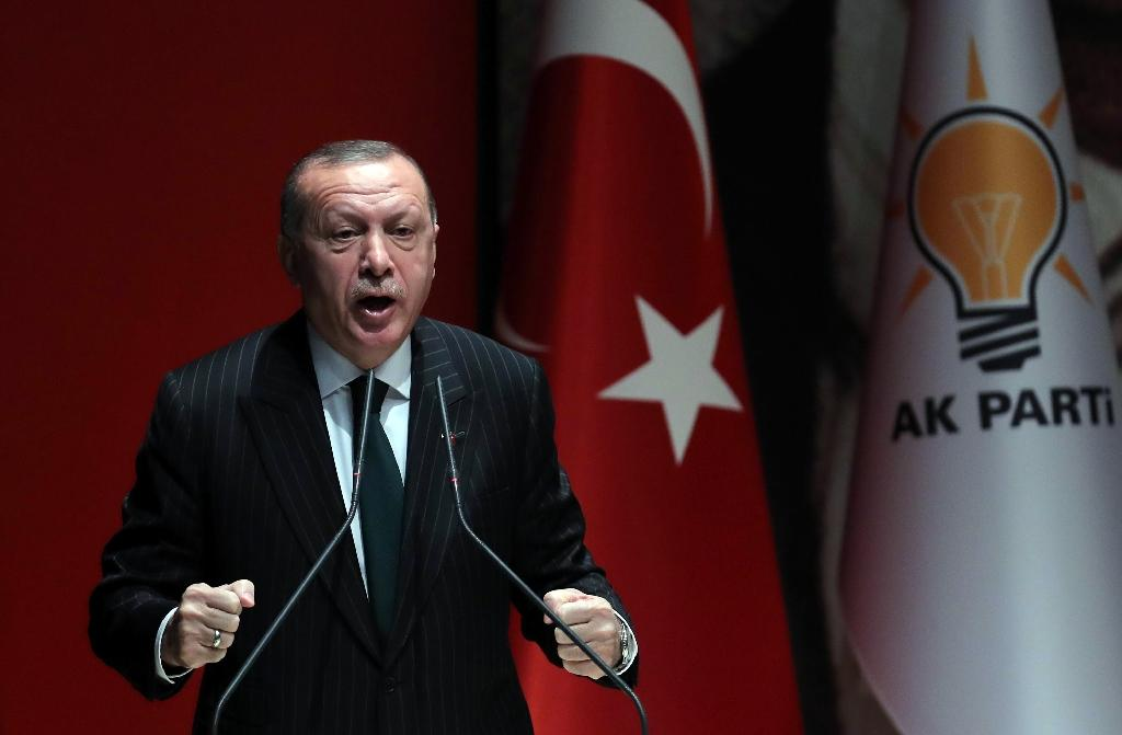 President of Turkey and ruling Justice and Development (AK) Party chairman Recep Tayyip Erdogan makes a speech during a meeting at party headquarters, in Ankara on December 6, 2018 (AFP Photo/ADEM ALTAN)