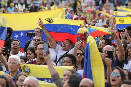 People attend a protest against Venezuela's President Nicolas Maduro's government at Plaza Bolivar in Lima