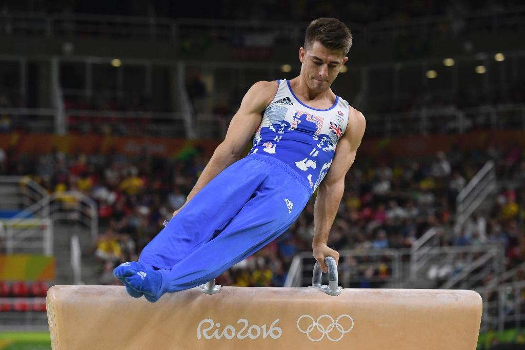 Britain's Max Whitlock competes in the men's pommel horse event final on August 14, 2016 (AFP Photo/Toshifumi Kitamura)