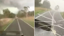 Incredible footage of truckie trying to escape Queensland tornado