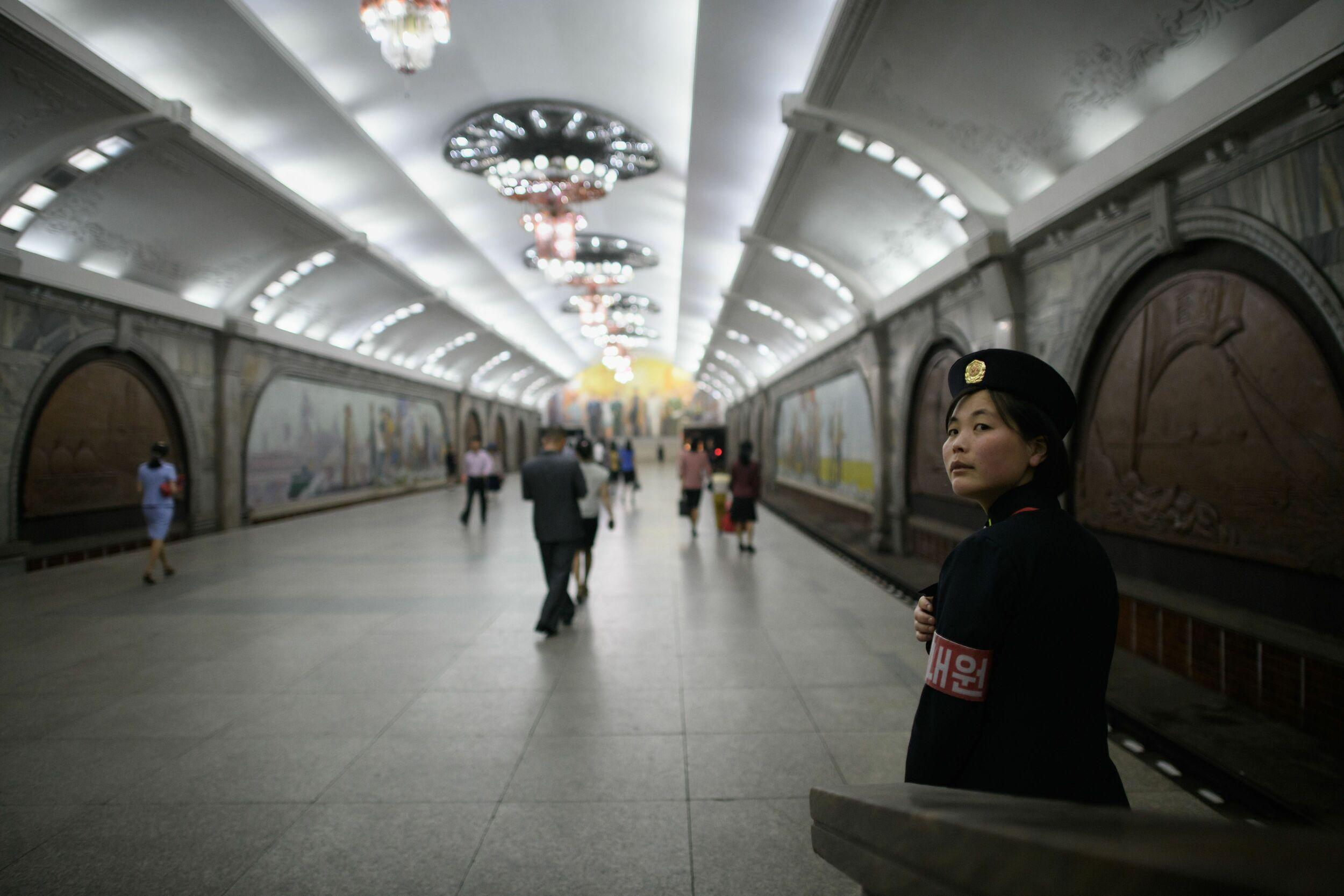 TOPSHOT - A conductor stands on a platform at a subway station of the Pyongyang metro on June 13, 2018. (Photo by Ed JONES / AFP)        (Photo credit should read ED JONES/AFP/Getty Images)