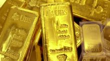 Gold falls to 3-week low, but notches solid monthly gain
