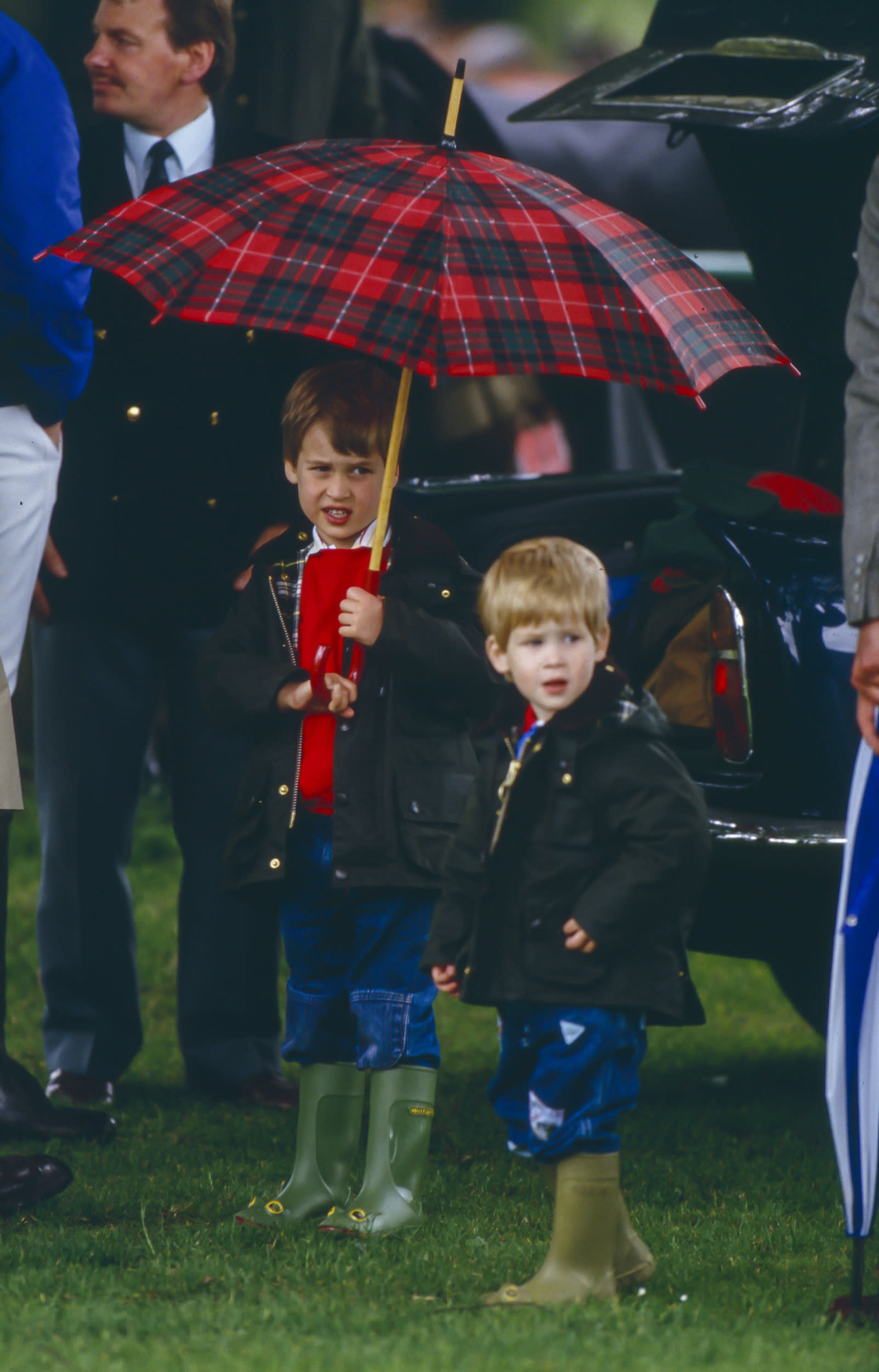 CIRENCESTER,  UNITED KINGDOM- JUNE 6:  Prince William, and Prince Harry, watch Prince Charles play Polo, at Cirencester Polo Club,  on June 6, 1987  in Windsor, United Kingdom . (Photo by Julian Parker/UK Press via Getty Images)