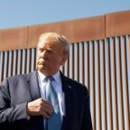 Video shows people scaling US border wall in seconds - despite Trump insisting it 'can't be climbed'