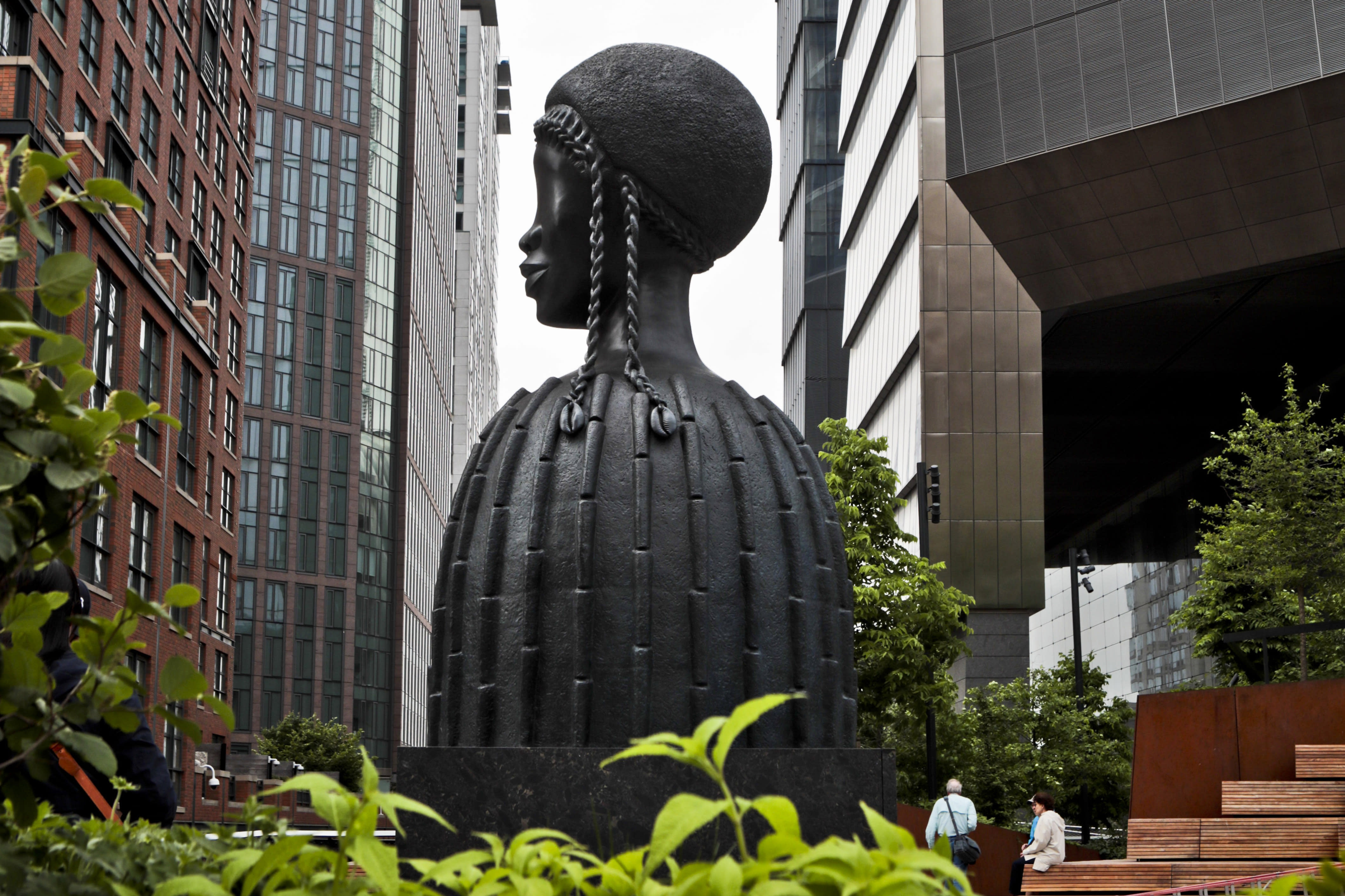 "In this May 29, 2019 , file photo, a bronze bust of a Black woman entitled ""Brick House,"" by Chicago artist Simone Leigh, stands among buildings and vegetation in the High Line park in New York. Leigh will be the first Black woman ever to represent the U.S. at Italy's prestigious Venice Biennale arts festival to be held in 2022. (AP Photo/Bebeto Matthews, File)"