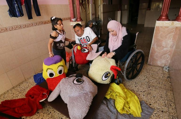 Nihad and his wife Zeinab generate a modest income by selling the dolls and by sending costumed performers to nurseries and schools (AFP Photo/SAID KHATIB)
