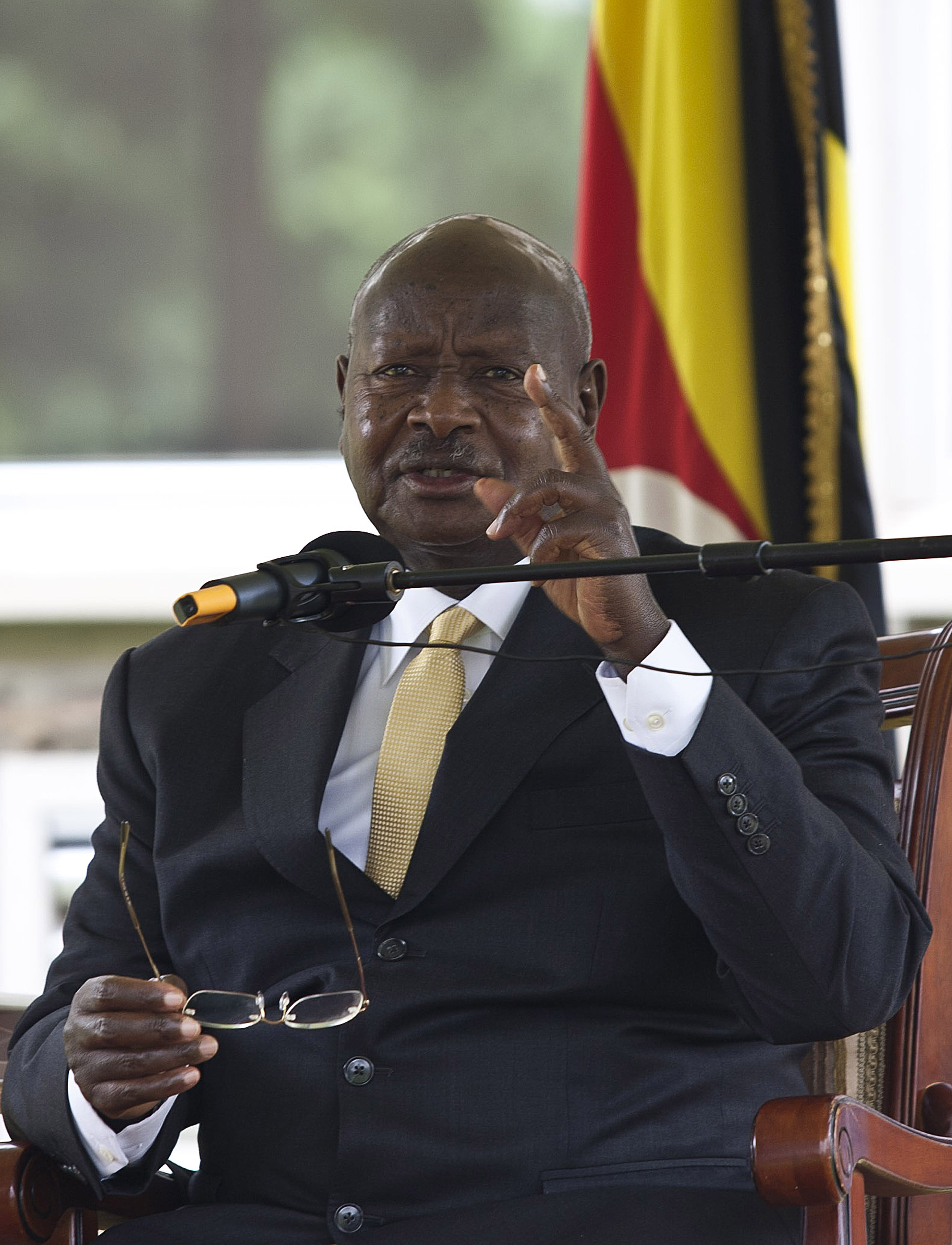 Ugandan President Yoweri Museveni, seen here on August 2, 2014 in Kampala, tells people to refrain from shaking hands amid virus threats (AFP Photo/Isaac Kasamani)