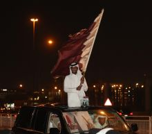 Thousands greet Qatar's emir on return home