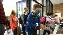 Masks the subject as virus-wary schools reopen across Europe