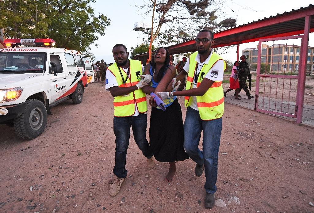 Paramedics help a student after Al-Qaeda-linked Shebab gunmen attacked the Moi University campus in Garissa on April 2, 2015 (AFP Photo/Carl de Souza)
